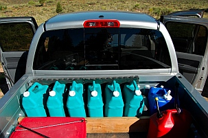 We haul 36 gallons of water in the back of our pickup to supplement our 70 gallon tanks in our trailer.