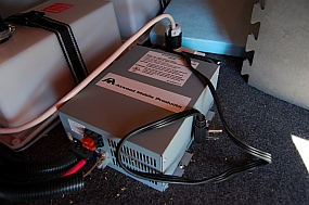 Atwood DC converter converts AC to DC when plugged into shore power; charges batteries when using shore power.