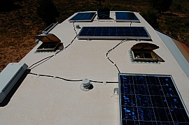 A robust RV solar power solution: 4 solar panels, (1) 130 watt Kyocera solar panel and (3) 120 watt Mitsubishi solar panels on the roof of the RV
