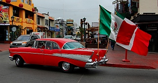Ensenada vintage car with Mexican flags flying