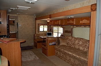 The 27' Fleetwood Prowler Lynx 270FQS travel trailer RV has an open floorplan -- good for fulltime RVers like us