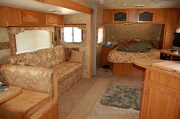 A 27' travel trailer, the Fleetwood Prowler Lynx 270 FQS, has enough space for a part-time RV lifestyle but not enough for fulltiming