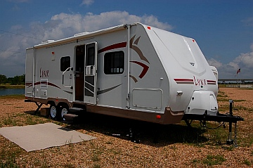 We lived fulltime in our Fleetwood Prowler Lynx 270 FQS travel trailer, a good RV for fulltiming!