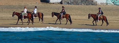 Horseback riding on Playa Miramar Bahia Santiago, Colima, Mexico