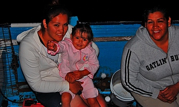 A family on a fishing panga visits in San Evaristo, Baja California Sur, Mexico
