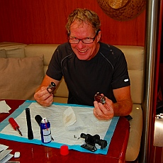 Mark rebuilds a solenoid for one of s/v Groovy's heads in Loreto, Baja California Sur, Sea of Cortez, Mexico