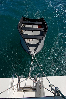 Porta-bote being towed by sailboat