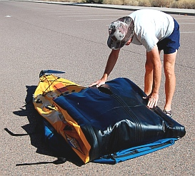 Putting away the Hobie i14t inflatable tandem kayak - fold it in thirds
