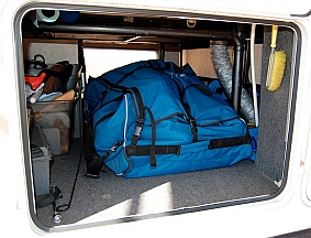 Hobie i14t inflatable tandem kayak takes up most of the space in a fifth wheel basement