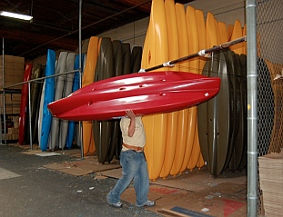 New kayaks lined up ready to sell