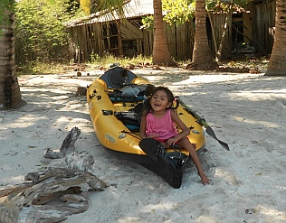 Little girl sits in our kayak at Isla de Ixtapa, Mexico.