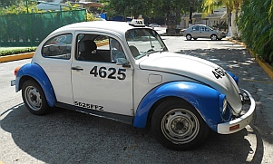 Blue and white VW bug taxis in Acapulco