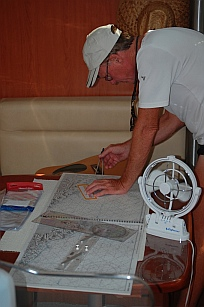 We check our position on the paper nautical charts.