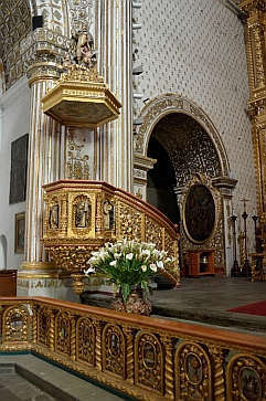 Ornate gold trimmed pulpit inside the Santo Domingo Cathedral in Oaxaca, Mexico