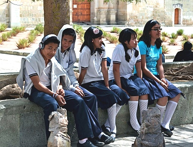 Kids hang around the Oaxaca, Mexico cathedral after school