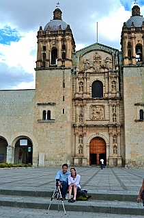 Tourists make a home video in front of the Santo Domingo Cathedral in Oaxaca Mexico.