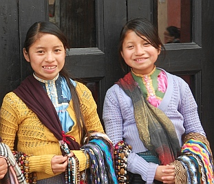 Mayan girls pose for a photo - for 5 pesos each - San Cristobal de las Casas, Chiapas, Mexico