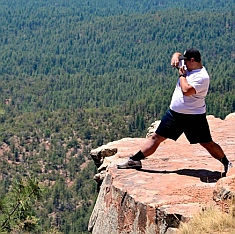 Getting a photo from the scary edge of the Mogollon Rim, Arizona.