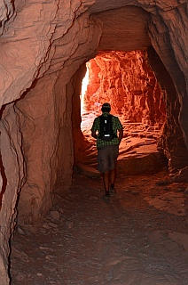 We hike through a tunnel on the White House Ruin hike in Chelly National Park, Arizona.