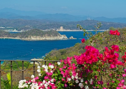 View of Chahue Bay from Las Palmas Resort in Huatulco Mexico from our sail blog