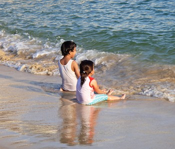 Toddlers on Santa Cruz Beach Huatulco Mexico sailing blog