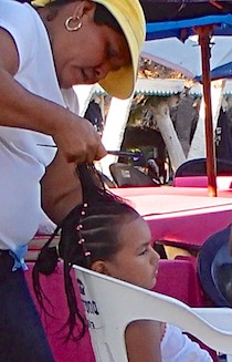 Lots of hair braiding on Santa Cruz Beach in Huatulco Mexico