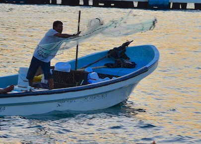 Fishing near Groovy in Santa Cruz Bay anchorage Huatulco Mexico sailing blog