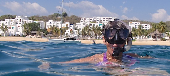 Enjoying snorkeling off Camino Real Zaashila in Huatuclo sail blog