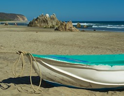 from our sailing blog - a boat at Playa La Bocana Huatulco Mexico