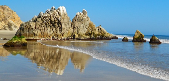 While sailing Mexico - mirrored rocks at Playa La Bocana Huatulco Mexico