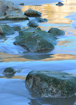 Glassy sand and rocks at Playa La Bocana Huatulco Mexico from our sail blog