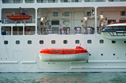 Cruise ship Regatta in Huatulco lowers liferaft (from our sail blog)