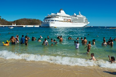 Cruise ship and beach scene from our sailing blog
