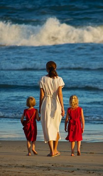 A mom and her two daughters all dressed to match at Playa La Bocana Huatulco