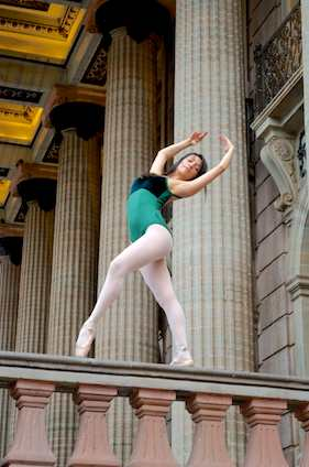 Ballerina on Teatro Juarez railing