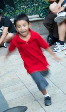 Kid running at the bandstand