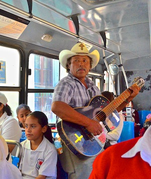 guitar player on the bus