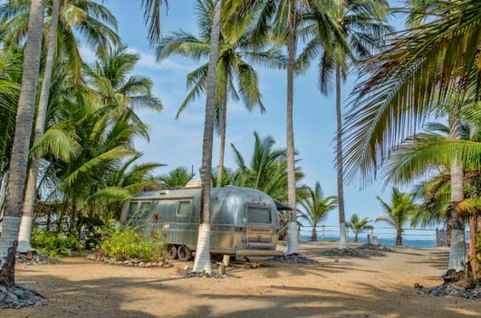 Airstream camping on the beach