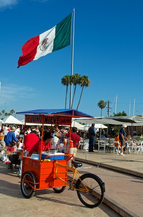 Mexican Flag and cart in Ensenada
