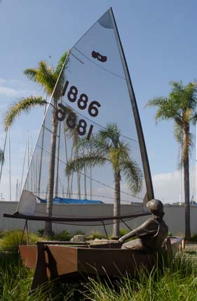 Kid in a sailboat sculpture