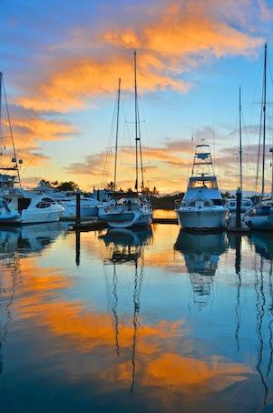 Sunset over sailboats at Paradise Village Marina