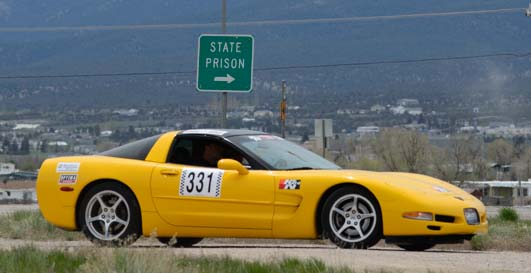 Corvette drives by state prison sign