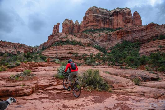 Mountain biker struggles up stairs at Cathedral Rock in Sedona AZ