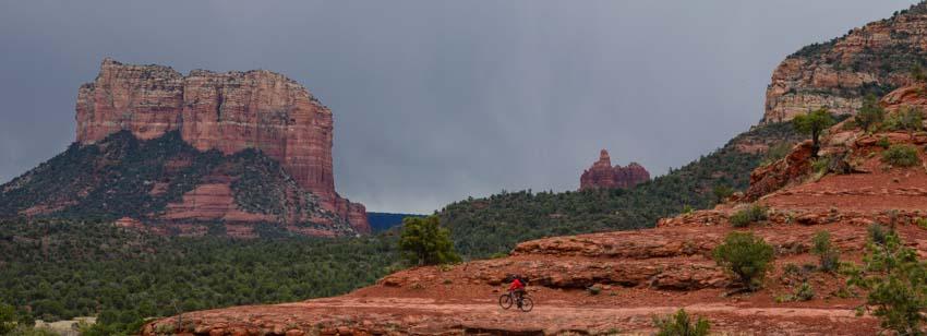 Mountain biker rides slick rock Templeton Trail in Sedona Arizona