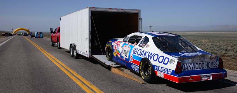 2001 Monte Carlo NASCAR racer unloaded from truck