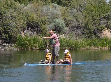 Family on standup paddleboard Deschutes River Bend Oregon