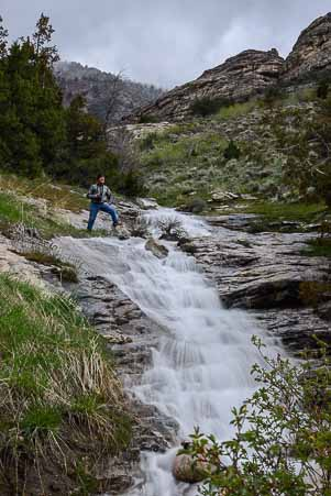 Mark looks down a waterfall in Lamoille Canyon