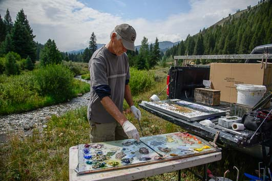 Robert Moore creates colorful paintings in the national forest of Idaho