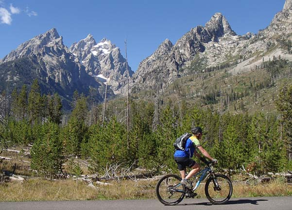 Riding a bicycle with a view of the Tetons