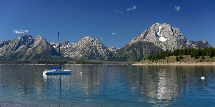 A sailboat anchored in Jenny Lake Wyoming